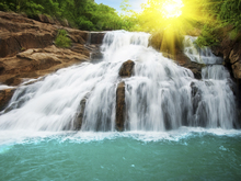 Fototapet - Waterfall in Rain Forest and Sunlight