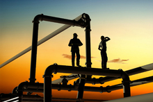 Fototapet - Oil Workers and Pipes in Sunset