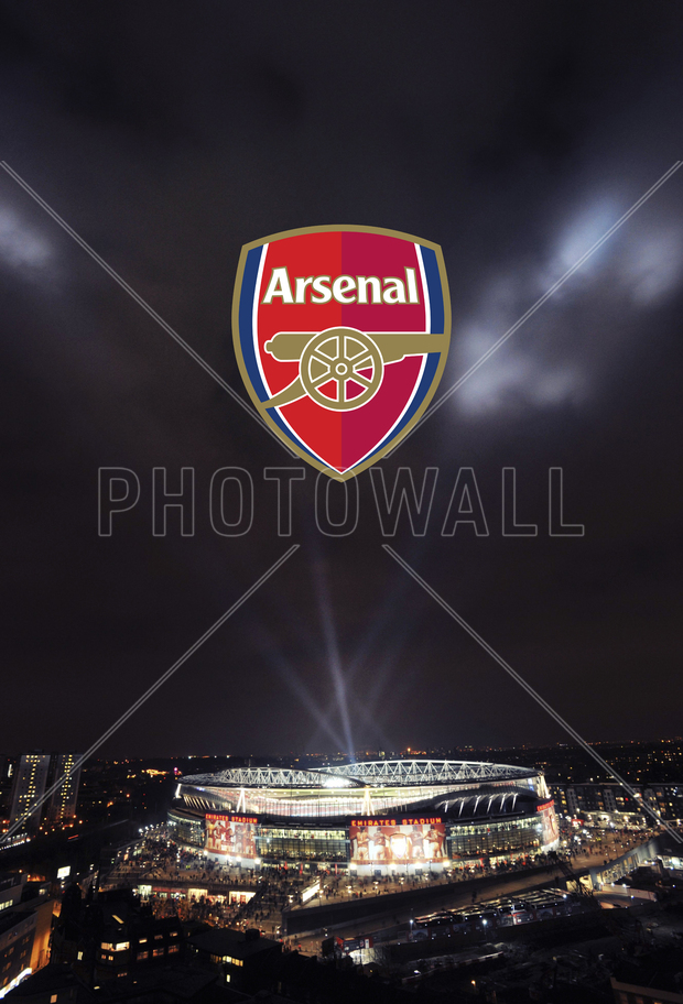 arsenal emblem over shimmering emirates stadium wall