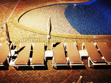 Wall mural - Sunbed by Pool