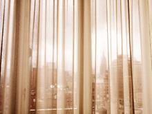 Wall mural - New York City through Curtains