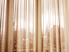 Wall mural - New York City through Curtains