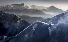 Fototapet - Skier on Mountain Top