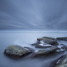 Fototapet - Foggy Stones in Blue Sea