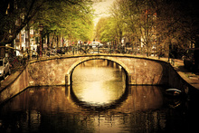 Fotobehang - Romantic Bridge Over Canal in Amsterdam