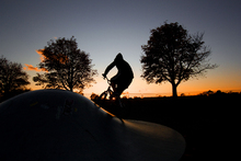 Fototapet - BMX Biking at Sunset