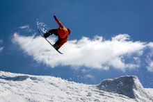 Fototapeta - Snowboard Jump from Ramp