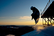 Fototapet - Snowboarder Jump from a Bridge