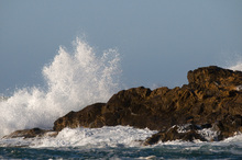 Fototapet - Wave Breaking over Rock