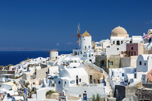 Canvas print - White Houses and Azure Blue Sea in Greece