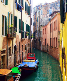 Canvas print - Coloured Boats Moored in Back Street Canal