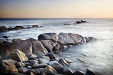 Canvas print - Sunlit Rocks at Dawn