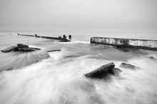Canvas print - Overflowing Sea Water in Mono