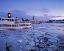 Canvas print - Archipelago Boat in Ice Covered Riddarholmen