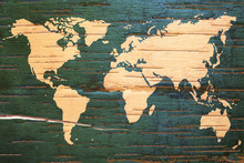 Fotobehang - World Map on Wooden Wall