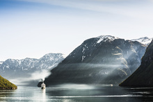 Canvas print - Cruise Boat Passes Geiranger Fjord, Norway
