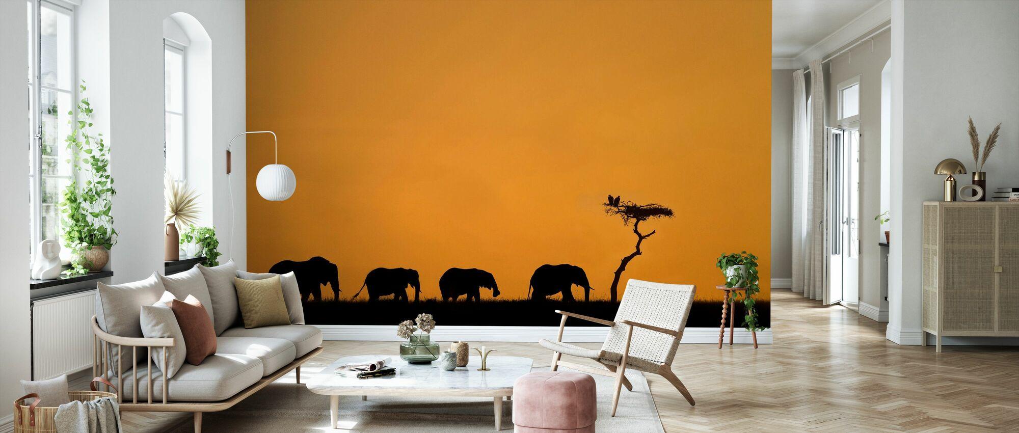 Hjord av elefanter och gamar vid soluppgången - Tapet - Vardagsrum