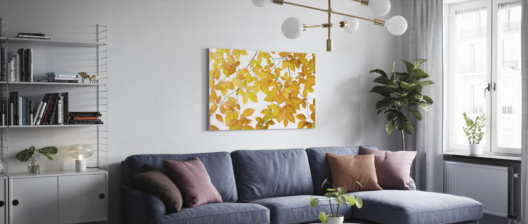 Gule blader på hvit bakgrunn - Lerretsbilde - Stue