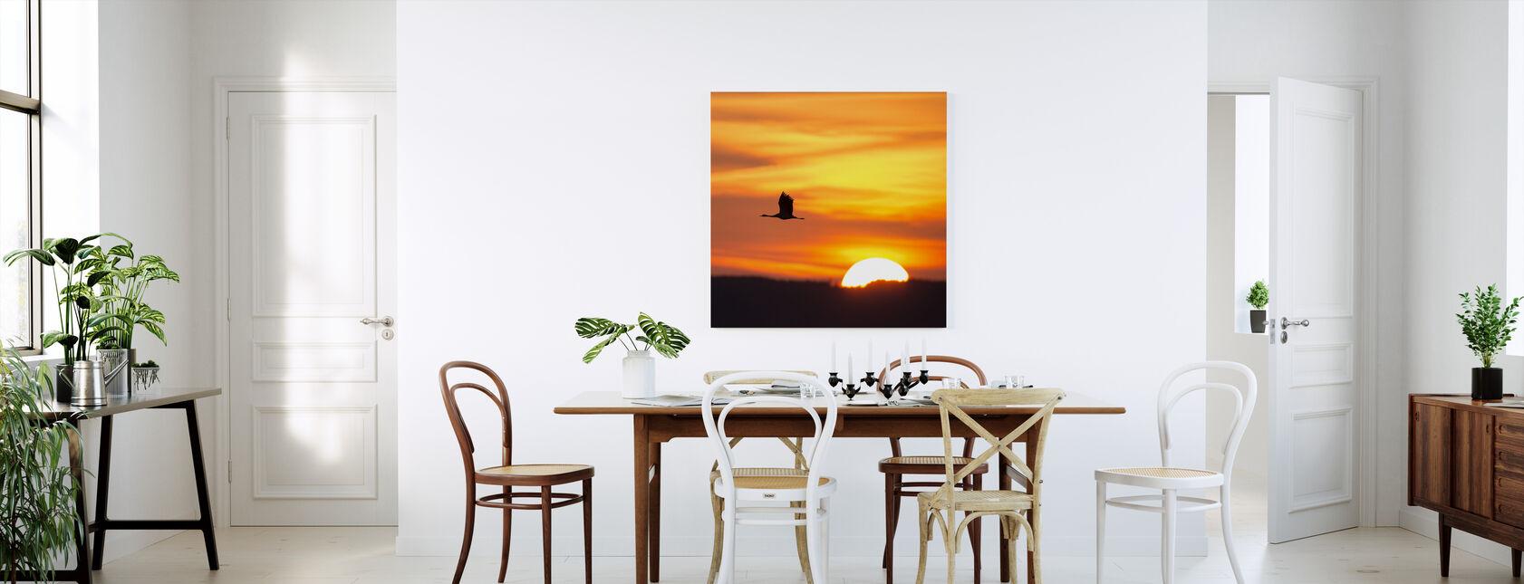 Kran og en smuk solopgang - Billede på lærred - Køkken