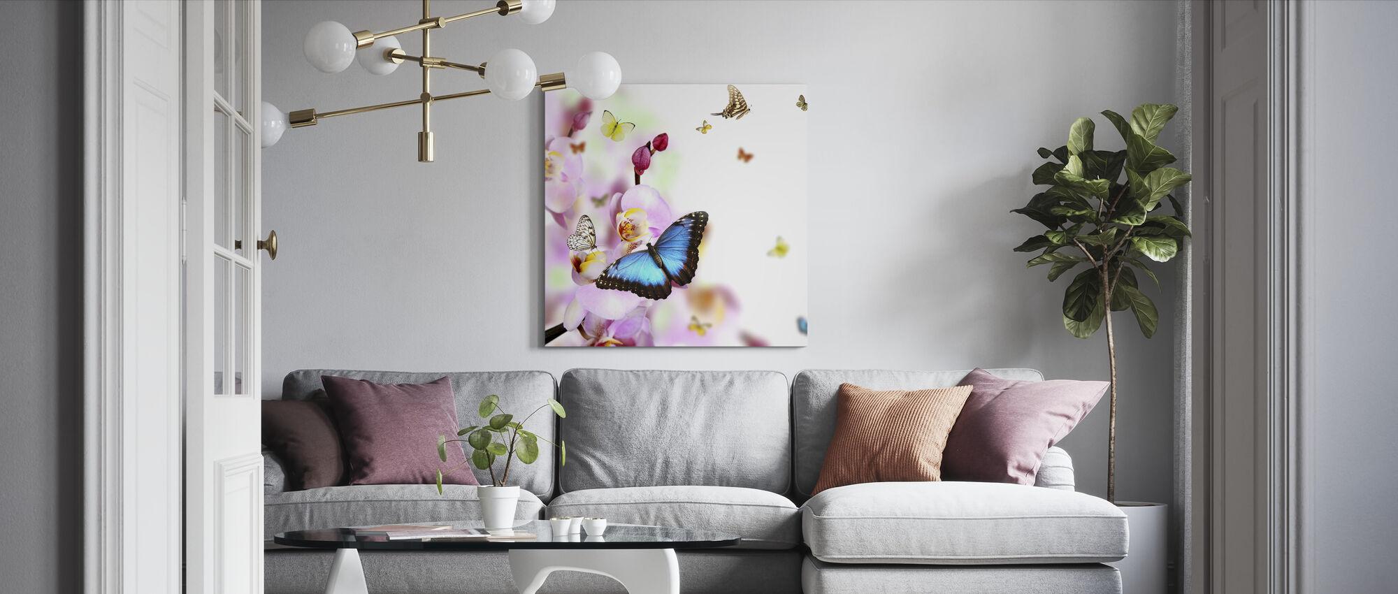 Perhoset ja orkidean kukat - Canvastaulu - Olohuone